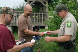 Conservation Police Officer showing a permit