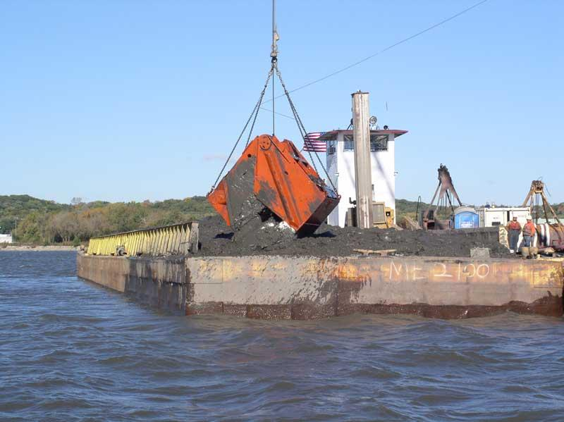 Image of crane on barge dumping sediment