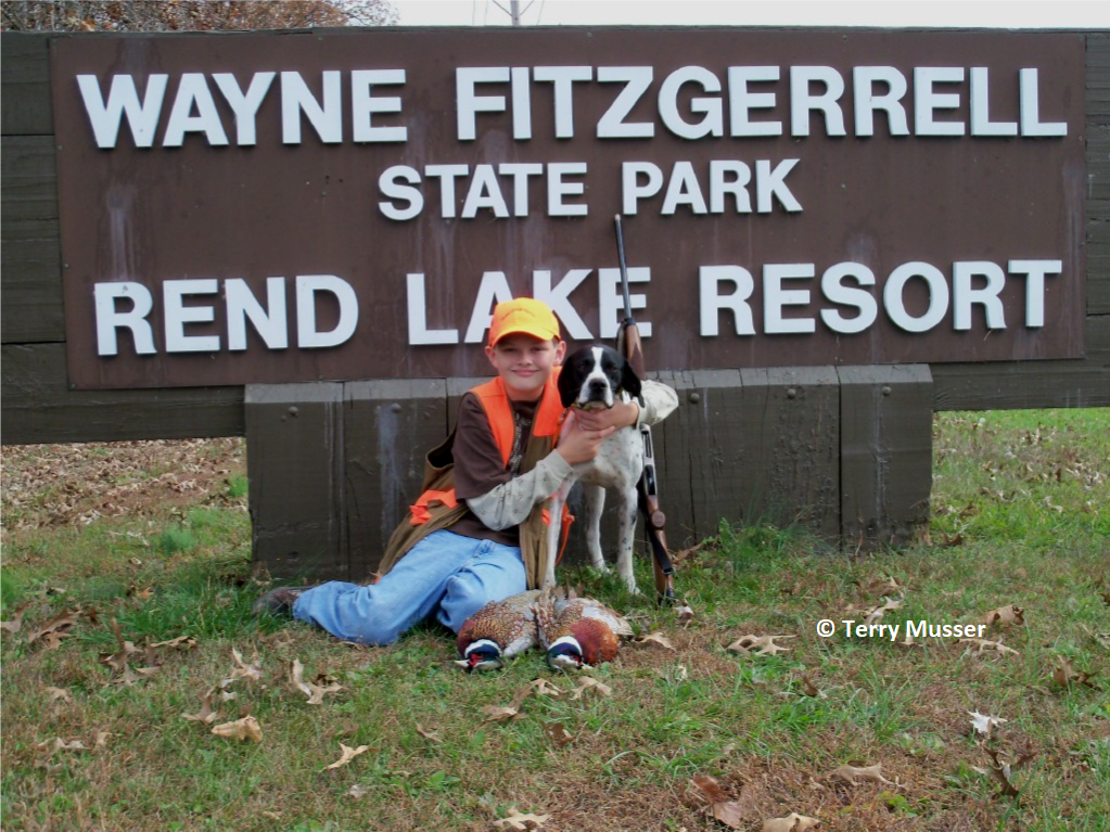 https://www2.illinois.gov/dnr/hunting/uplandgame/PublishingImages/Youth_Pheasant_hunter.png