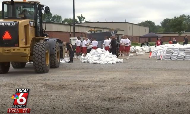 """It's way more than bags for me"": Illinois inmates bag thousands of sandbags for flood victims"