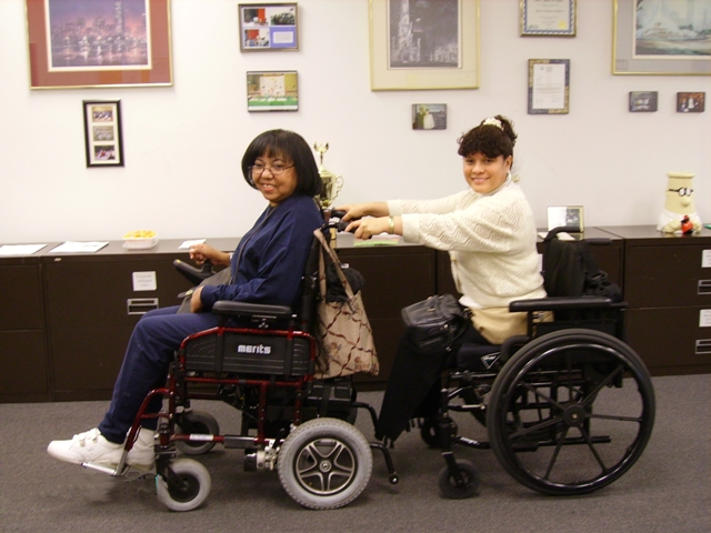 two members in wheel chairs