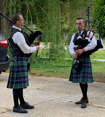 Damon and Aidan playing bag pipes